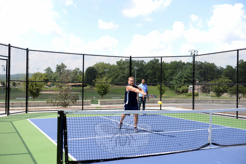 Willy Drucker slams the ball across the net while his partner Neeraj Kuman is ready to play a hit to the back of the court. (Bobowick photo)