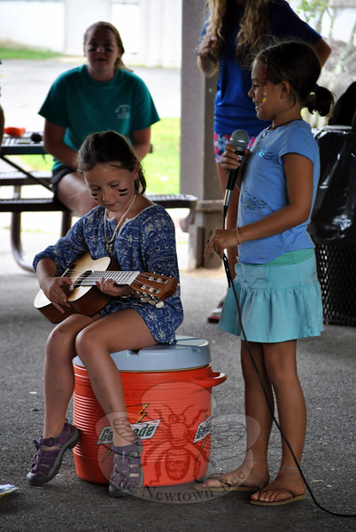 "Two daycampers perform ""Happy Birthday"" for their counselor, Leah, inspiring the entire crowd to join in. (Crevier photo)"