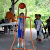 A camper dunks the basketball during a basketball routine set to music, and performed by 7- and 8-year-old boys from Dickinson Day Camp. (Crevier photo)