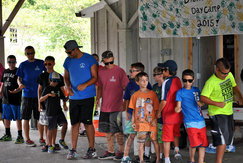 "Nine, 10- and 11-year-old boys from Treadwell Day Camp and their counselors close out the year-end talent show, performing to NSync's ""Bye, Bye, Bye."" The song was particularly appropriate, as this is the year many of the boys age out of the town's day camps. (Crevier photo)"