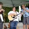 Bill Wisnowski, left, and Leif Smith, right, accompany Susan Lang with the folk sounds of My Dad's Truck on August 16, for the kick-off performance in the Choose Love Concert Series. The Sandy Hook Organization for Prosperity (SHOP) is hosting the event held outdoors, on the Sandy Hook Village Green, weekly through mid-September. (Bobowick photo)
