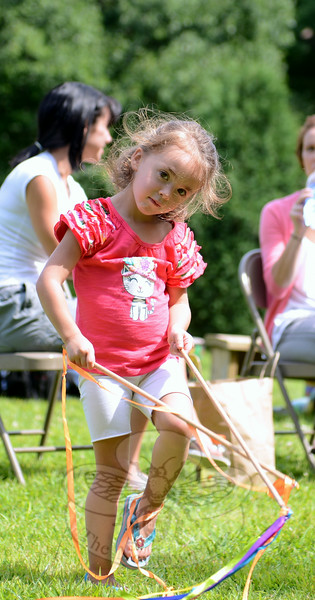 Isabella Burgos spun ribbons and twirled around during the first in a community concert series in Sandy Hook last weekend. (Bobowick photo)