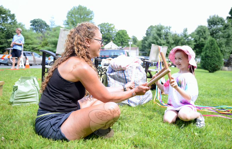 Janet Maurice of Trumbull, who started the My Circles of Love community outreach organization following 12/14, brought various toys for children to enjoy to debut concert of the Sandy Hook Choose Love Concert Series. She sat with Hayden Hughes, playing with drumming sticks, on August 16. (Bobowick photo)