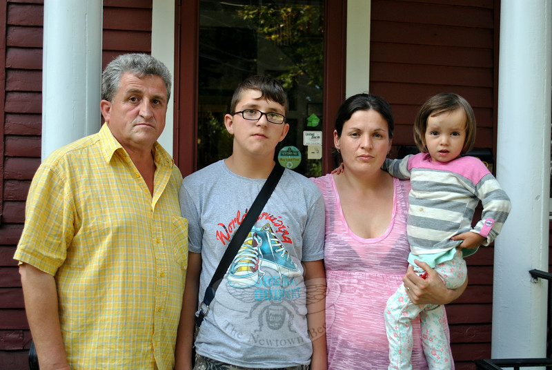 From left, Jusuf Lajqi and son, Arben, and Hikmete Ymeraj and her daughter, Leona Hoti, all of Kosova, pause in front of The Newtown Bee office Monday afternoon, August 18, where they met with area Rotary members. Arben and Leona are in the United States for lifesaving heart surgeries, scheduled for August 20, thanks to the Rotary Gift of Life Newtown Initiative. (Crevier photo)