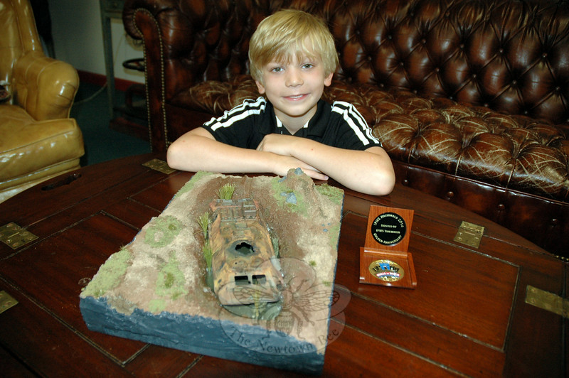 Rising Hawley Elementary School fourth grader Conrad Chapman with his first place winning entry from the International Plastic Modelers Society USA 2014 National Convention, and a medal he earned fort his work. (Hallabeck photo)