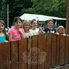 Housatonic Valley Waldorf School summer campers lined a fence at the school to welcome attendees to a harvest feast on Friday, August 15. (Hallabeck photo)