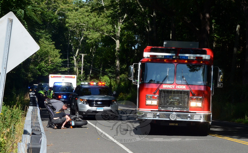 Police, fire, and ambulance crews responded to a motorcycle accident near 100 Berkshire Road (Route 34), west of Zoar Road, about 9:23 am on August 18. Police said Terry Hurd, 46, of Bethel was riding a 2011 Yamaha FZ6R eastward on Berkshire Road, when he lost control of the motorcycle and it fell onto its side, causing Hurd to fall off the vehicle. Hurd, who was conscious and alert, was transported by ambulance to Danbury Hospital for treatment of arm injuries, police said. On August 26, Hurd received a violation for failure to have insurance, police said. (Voket photo)