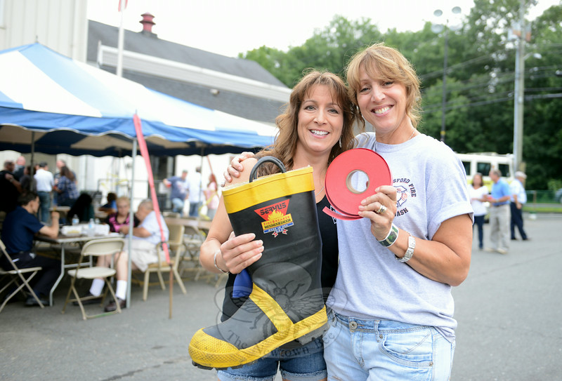 Mary Braga, left, and Fran Pizighelli raised money with a raffle during the annual Botsford Fire & Rescue Summer Bash on August 23. (Bobowick photo)