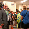 Newtown Middle School Principal Thomas Einhorn greeted students as they walked through the lobby of the Queen Street school for the start of the new school year. (Hallabeck photo)