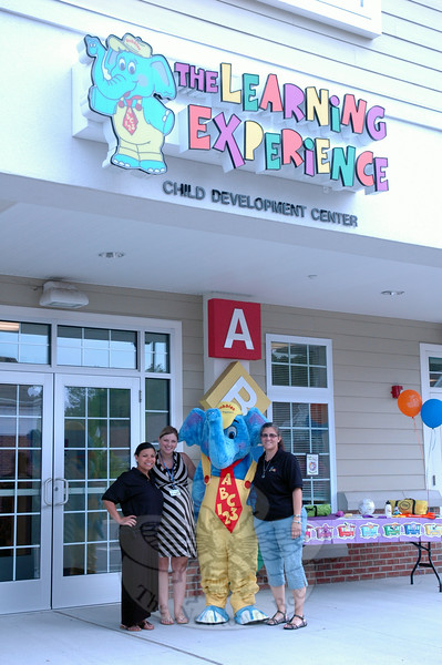 "The Learning Experience (TLE) in Newtown, an early learning academy for children 6 weeks to 6 years old, hosted a ""Back to School Bash"" on Thursday, August 21. Community members were welcomed and a variety of activities were available, like a bounce house, face painting, and crafts. From left to right, Director Wendy Arroyo, Center Business Manager Meghan Markey, TLE mascot Bubbles, and TLE Area Manager Christy Cotton stood together during the event. (Hallabeck photo)"