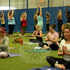 The Second Annual Newtown Yoga Festival held at NYA Sports & Fitness Center at Fairfield Hills on Saturday, August 23, attracted about 150 participants for a day of physical, mental, and spiritual dis-cipline. Those seated in the foreground are practicing Kundalini yoga.  (Gorosko photo)