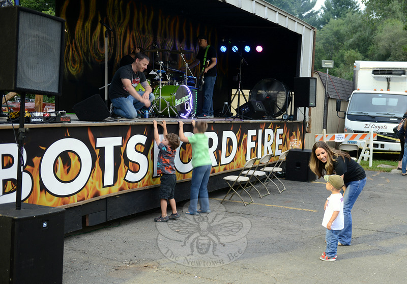 Lisa Paloian and her son Mikey approach the stage and Fast Ricky band members Saturday afternoon at the annual Botsford Fire & Rescue Summer Bash. (Bobowick photo)