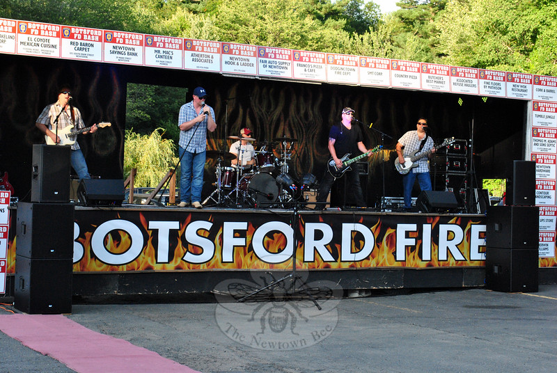 Nashville Drive, a modern country band, performed original songs and covers during Botsford Fire Rescue's Annual Fundraiser/Summer Bash. (Hallabeck photo)