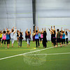 A group followed Newtown energy healer and yoga teacher Joanne Keane, not shown, through Journey Dance, a physical and emotional movement practice. (Hallabeck photo)