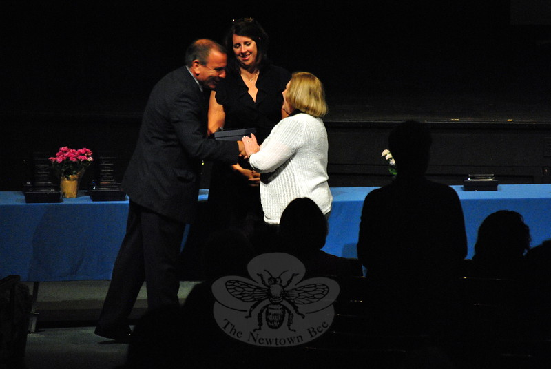 Mimi Riccio, right, was one of many district employees highlighted during the Convocation 2015 event on Monday, August 24, for having more than 25 years of experience in the district. Superintendent of Schools Joseph V. Erardi, Jr, left, and Board of Education Vice Chair Laura Roche greeted each em-ployee honored during the event. (Hallabeck photo)