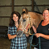 Equine therapy riding instructor Diana Kruzshak, left, and Chris Patella, director of the Therapeutic Recreational Center in Woodbridge and Animal-Assisted Therapy Services in Guilford, pose with therapy horse Texas at Timber Hill Farm. Ms Kruzshak and Ms Patella have joined with farm owner Barbara Gaydosh to open Animal-Assisted Therapy Services in Newtown, serving emotionally and physically challenged people of all ages, at Timber Hill Farm. (Crevier photo)