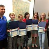 Reed Intermediate School math/science specialist Andrew Hall, left, and Principal Anne Uberti, right, stood with rising sixth grade students, from left, Mitchell Doherty, Justin Peck, Tyler Hill, Jillian Reilly, and Maddie Hintz during a Board of Education meeting on August 18, when they were recog-nized for completing a science project as fifth grade students during the 2014-15 school year. (Hallabeck photo)