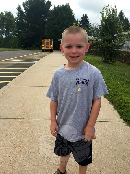 Middle Gate Elementary School kindergartener Matthew Stoerzinger smiled right after stepping off of his bus for the first time at the school on Tuesday, August 25. (Hallabeck photo)