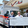 "What was initially going to be a $500 check presentation to the Newtown Volunteer Ambulance Corps ended up doubling to $1,000 after Newtown Verizon Wireless store operators met Corps Chief Michael Collins, center, and learned the funds would underwrite the replacement of a damaged heart-starting and potentially life-saving automatic external defibrillator or AED. Verizon Regional Manager Tamar Bundy, far right, and store manager Chris Faett also challenged other Newtown businesses to match their donation to replace the all the aging AEDs on Newtown's three ambulances, which are staffed by an all-volunteer corps of emergency medical responders. Any local business or business person wishing to answer the ""defibrillator donation challenge"" can contact Chief Collins at 203-313-7674 or chief@newtown-ambulance.org.  (Bee Photo, Voket)"