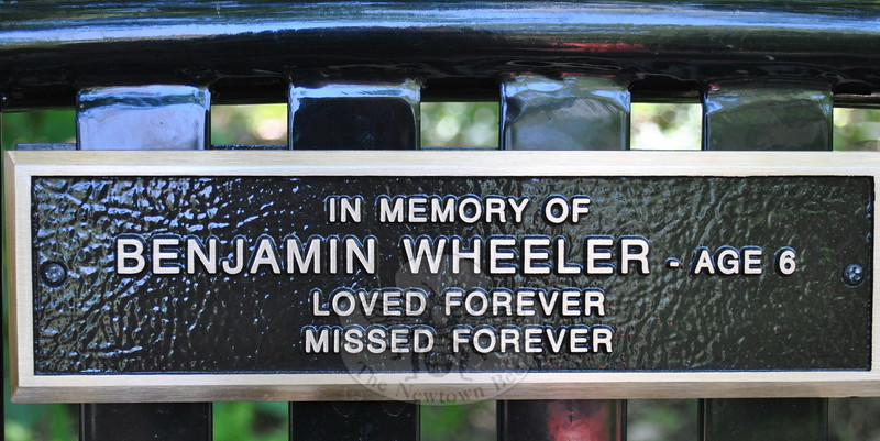 A bench honoring the memory of Ben Wheeler is one of two benches located near the rabbit house at The Pleasance.  (Bee Photo, Crevier)