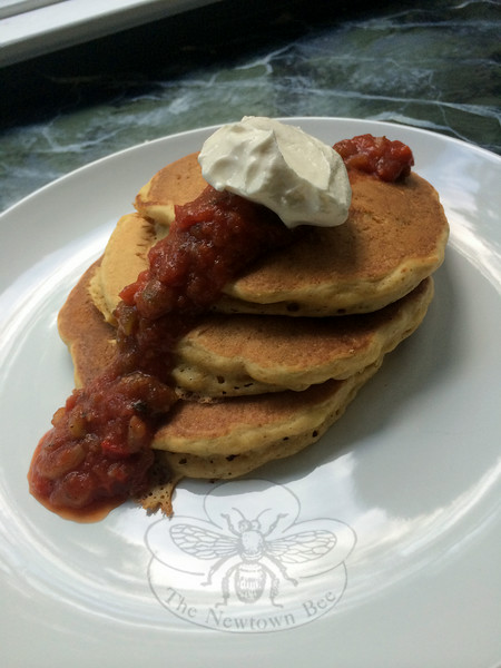 Cornmeal pancakes enhanced with kernels of fresh corn, and topped with salsa and sour cream, become a dinnertime version of a breakfast favorite. (Crevier photo)
