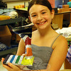 Drawing Mixed Media student Julia Levine held up a sculpture she made during the weeklong camp. (Gaston photo)