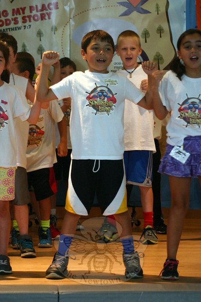"Third grade students, at left andright/top and bottom, sang ""Power"" during the EVBS Scavenger Hunt Closing Assembly, which also include a prayer by Monsignor Robert Weiss, introduction by EVBS Coordinator Rachel Torres-O'Leary, and brief closing remarks by Pam Arsenault, who also helped organize this program this year. (Hicks photo)"
