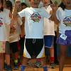 """Third grade students, at left andright/top and bottom, sang """"Power"""" during the EVBS Scavenger Hunt Closing Assembly, which also include a prayer by Monsignor Robert Weiss, introduction by EVBS Coordinator Rachel Torres-O'Leary, and brief closing remarks by Pam Arsenault, who also helped organize this program this year. (Hicks photo)"""