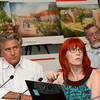 Landscape architect Bill Richter, left, and architect Julia McFadden made a presentation on July 31 to the Planning and Zoning Commission (P&Z) on the proposed new Sandy Hook Elementary School. At the rear is Robert Mitchell, chairman of the town's Public Building and Site Commission. In the back-ground are some renderings of the school project.  (Gorosko photo)