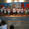 """Newtown's Ecumenical Vacation Bible School (EVBS) has a Scavenger Hunt theme this year, but parents did not have to hunt too hard to find the finalé celebration for this year's program. The Gathering Hall at St Rose of Lima was filled with a few hundred people on Friday, July 25, as children from pre-K through grade 6 performed songs for friends and family before enjoying snacks and heading home. Eight songs were performed that morning, including """"A Friend Loves"""" by the first grade students, shown here (getting a little bit of help from the sidelines). This year's VBS, which was again a collaborative effort between the host church as well as Newtown Congregational, Newtown United Methodist, and Trinity Episcopal churches, welcomed 290 campers. A team of 45 adults and 89 youth workers ensured the success of the program. (Hicks photo)"""
