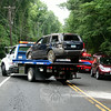 Police report that at about 10:26 am on August 3, motorist Joey Branco, 21, of Monroe was driving this 2001 Jeep Grand Cherokee SUV westward on Berkshire Road, near Sherman Street, when he lost control of the vehicle on the wet pavement and then struck an embankment along the right road shoulder, causing the vehicle to roll over. Newtown Volunteer Ambulance Corps transported Branco to Danbury Hospital, police said. Sandy Hook volunteer firefighters also responded to the accident. Police said they issued Branco an infraction for traveling too fast for conditions and for making a restricted turn.  The vehicle was towed from the scene. (Hicks photo)
