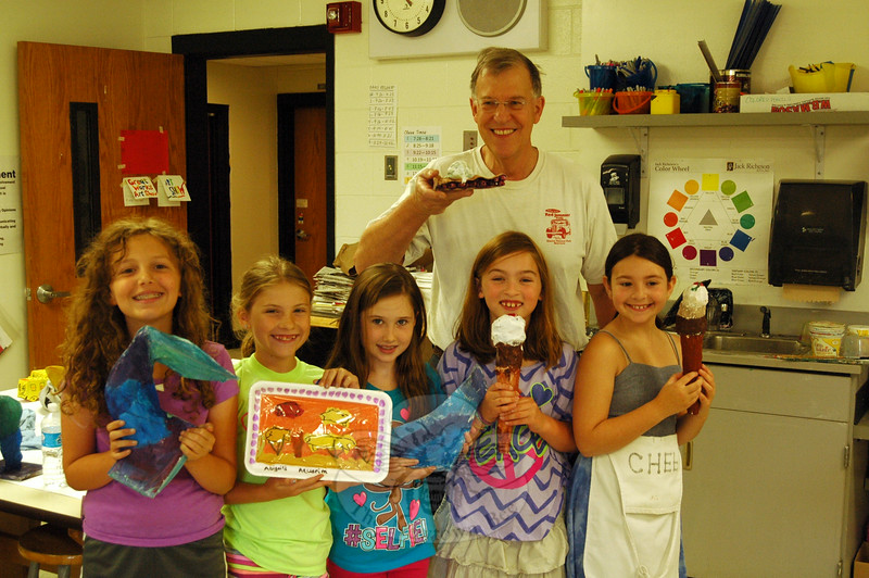 Drawing Mixed Media instructor Chuck Fulkerson posed for a picture with his students, who each held up their favorite project. Students from left are Lauren Uffer, Abigail McManus, Allison Briggs, Emily Joyce, and Julia Levine. (Gaston photo)