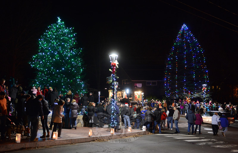 Shadows against a dark night lit to reveal trees strung with dazzling lights Saturday, December 5. Guests to Sandy Hook Center fill the hillside and intersection of Riverside Road and Washington Avenue, and Church Hill and Glen Roads to watch the annual tree lighting. (Bobowick photo)