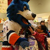 Ahead of a Head O' Meadow Family Fun Night with the Sound Tigers, held on December 5 at Webster Bank Arena in Bridgeport for the team's game against the Portland Pirates, Storm, the team's mascot, visited Head O' Meadow Elementary School on Wednesday, November 18. Many students greeted Storm, brought to life by Tom Galatie, high fives and hugs, including twins Bryana, left, and Alexis Diaz. A portion of ticket sales for the Family Fun Night raised money for the school's PTA, and were being sold for $20 to school family members, according to PTA organizer Karen Roszman. (Hallabeck photo)