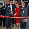 Bethel First Selectman Matt Knickerbocker, Maplewood Executive Vice President of Operations Shane Herlett, and Alejandro Knopoff of Perkins Eastman architecture firm look on as Maplewood Senior Living Chairman and CEO Greg Smith and Executive Director Eileen Duggan cut the ribbon at the grand opening of the new memory care community, Maplewood at Stony Hill. (Crevier photo)