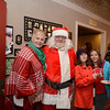 Mrs and Mr Claus started their Christmas celebration early with Camille Paradis and Alexa Unger, right. (Bobowick photo)