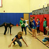 Pilobolus dancer Matt Del Rosario, upper left, works with a group of Reed Intermediate School students during a Pilobolus At Newtown session on December 2. Members of the contemporary dance company have been visiting the school weekly since mid-October, and will be performing alongside the students on December 19. (Hicks photo)