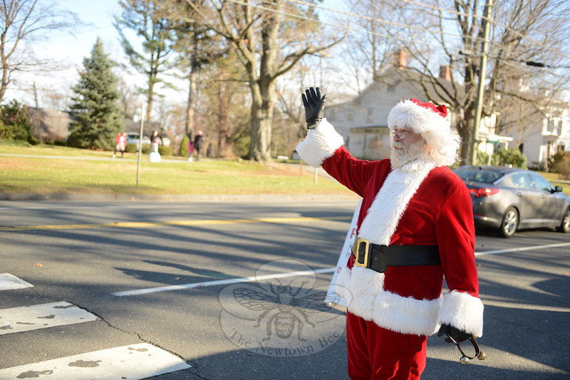Jolly Old St Nicholas (Joe Hemingway) waves to guests visiting Main Street homes, and enjoying festivities at the Edmond Town Hall during the annual Holiday Festival. (Bobowick photo)