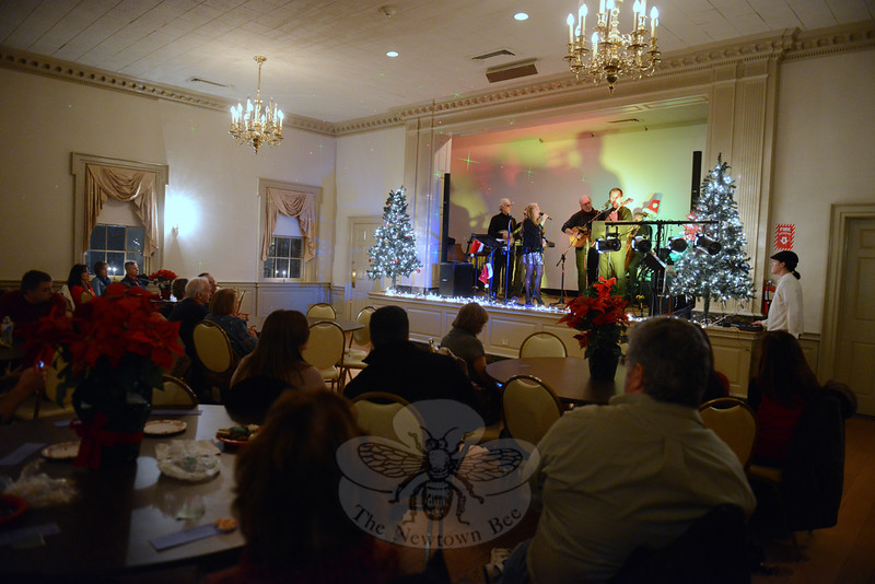 The Goldrush folk/bluegrass band played to guests filling the Alexandria Room Saturday evening, December 6. The band's Jingle Jam is the first for the annual Holiday Festival. (Bobowick photo)