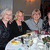 From left, Christina Jackson, Carole Ando, Lynn Welsh, Senior Center art instructor, and Carol Fraser, all members of the Senior Center knitting group, celebrate at the Holiday Party.  (Crevier photo)