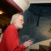 Homeowner Richard Mulligan welcomes guests throughout the day Sunday for a series of house tours during the annual Holiday Festival. He showed off rooms decorated for the season and also offered a dash of local lore. The story of the home's former owner, his death, and subsequent haunting are depicted in a mural in the stairwell. (Bobowick photo)