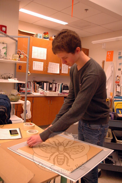 NHS Art Portfolio student Baxter Hankin worked on Wednesday, December 10, to make sure one of his works of art would be ready to be hung at the upcoming art show. (Hallabeck photo)