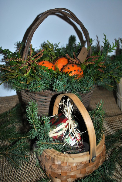 Baskets lined with fresh greens cradle homemade jam and clove studded oranges. (Crevier photo)