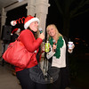 Meribeth Hemingway, right, and her daughter Sarah sang karaoke carols together while waiting for the tree lighting. (Bobowick photo)