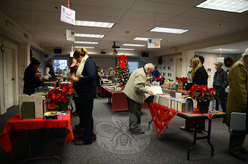 Shoppers browsed the selection of gifts and books at the Friends of the C.H. Booth Library Book and Gift Sale, Saturday, December 6. The Holiday Book and Gift Sale continued on Sunday, and shoppers were encouraged to support The Little Book Store on the main floor of the library, as well. (Hallabeck photo)