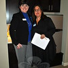 Mary Underwood, left, executive vice president of memory care and resident experience, and Andrea Ellen, vice president of marketing and communication, stand in the kitchenette of a studio-type apartment at Maplewood at Stony Hill. A microwave and a refrigerator provides a degree of autonomy to less-affected memory loss residents, but no apartment offers cooking appliances. (Crevier photo)