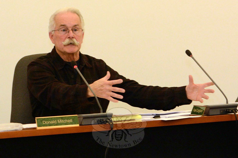 """Planning and Zoning Commission (P&Z) member Donald Mitchell makes a point during a December 4 P&Z session at which residents discussed a set of proposed zoning regulations that would cover high-density, multifamily housing complexes that would include an """"affordable housing"""" component. (Gorosko photo)"""