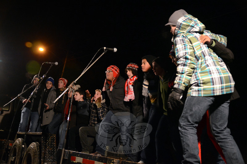 Newtown High School's a capella all-male singing group, the XY Chromotones, performed before both trees at Rams Pasture were lit on Friday, December 5. (Hallabeck photo)