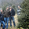 Caitlin Graaf, Andrew Moore, Greg Osborne, and Jen Castonguay pick out the perfect trees for their Bethel apartments during a snowy day visit to Paproski's Castle Hill Farm on Sugar Lane. Multiple family-owned tree farms in town allow people to cut their own Christmas trees. (Hutchison photo)