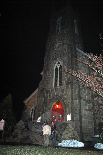 The interfaith service of prayer, Monday, December 14, draws people through the doors of Trinity Episcopal Church on Main Street. The foggy and rainy weather did not deter those seeking to remember lives lost three years ago at Sandy Hook Elementary School, and find solace in the gathering. (Crevier photo)